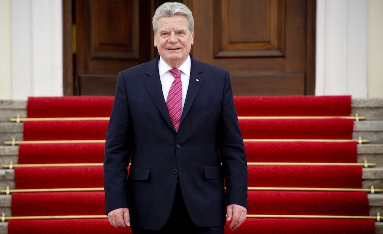 <p>German President Joachim Gauck stands outside his official residence, the Bellevue Palace, in Berlin on April 16, 2013.</p>