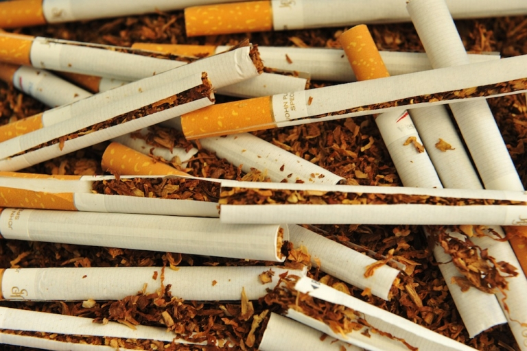 <p>Cigarettes are ripped off prior to be analyzed at the 'Seita-Imperial tobacco' research centre, on May 29, 2012 in Fleury-les-Aubrais, near Orleans, central France.</p>