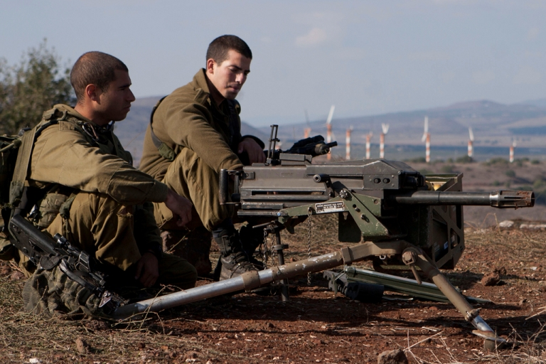<p>Israeli soldiers overlooking the ceasefire line between Israel and Syria in the Golan Heights.</p>