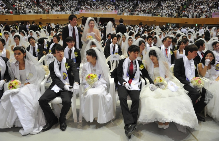<p>Newly-married couples sit down at the Unification Church's mass wedding held at the church's headquarters in Gapyeong, east of Seoul, on February 17, 2013. The Bank of Korea announced it was opening its auditorium up for weddings starting in May.</p>