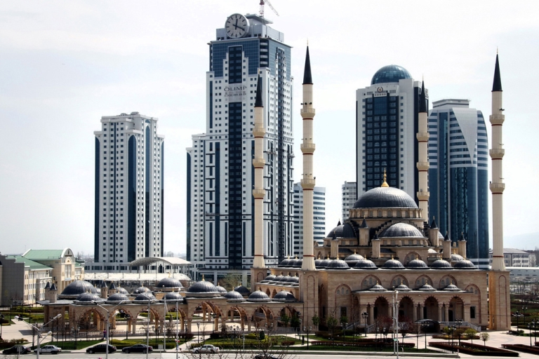 <p>A new skyscraper complex, Grozny-City, dominates the skyline behind Akhmad Kadyrov Mosque, known as 'Heart of Chechnya,' in Grozny on April 14, 2012. The tallest tower in the complex caught fire on April 4, 2013.</p>