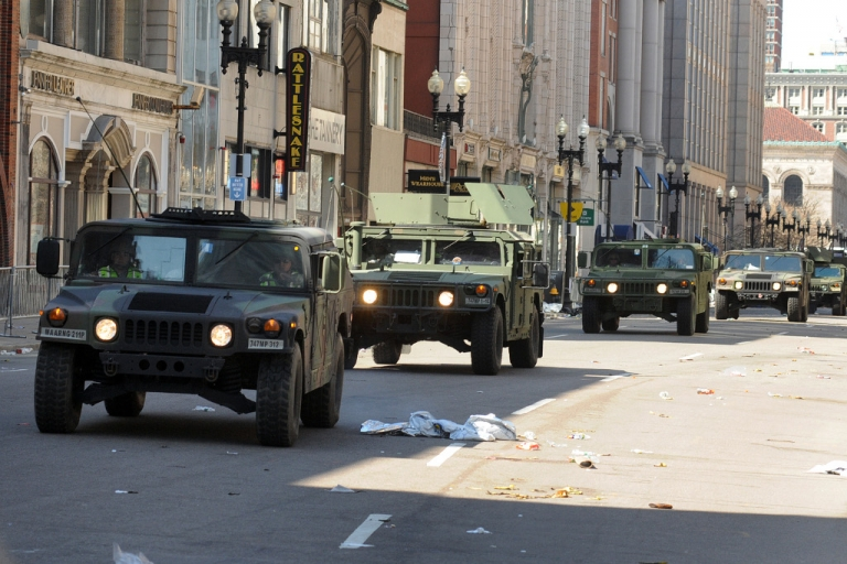 <p>US military Humvees rolling down a deserted Boylston Street April 16, 2013, which is considered a crime scene after two explosions rocked the Boston Marathon on Monday. There are no known additional threats following the bombing at the Boston marathon that killed three people and wounded more than 150, an FBI official said Tuesday.</p>