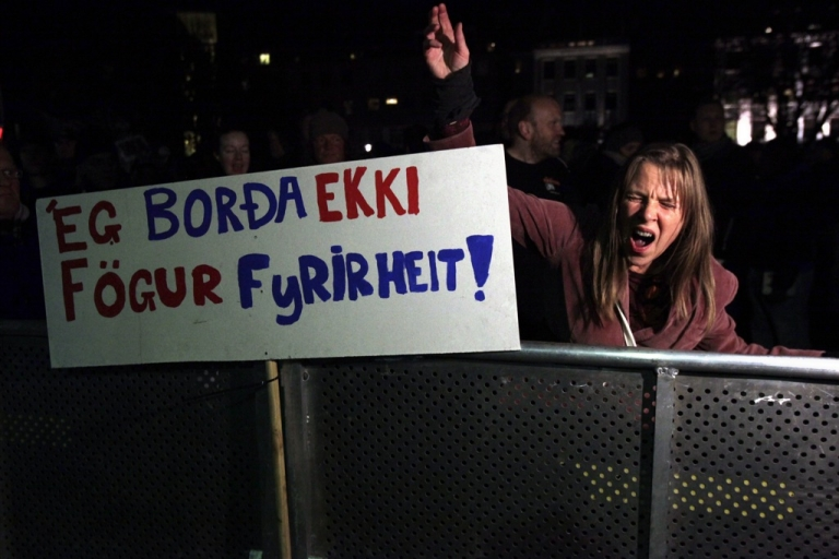 <p>People demonstrate outside the Icelandic parliament, Althingi, when parliament reconvened for the fall session on Oct. 3, 2011. An Icelandic court said it would hear a case against former prime minister Geir Haarde over his role in the 2008 collapse of the banking sector which brought the Nordic country to its knees.</p>
