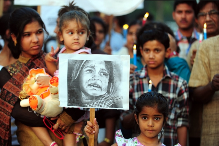 <p>An Indian child poses with a placard in a protest in Allahabad on April 23, 2013, following the rape of a five-year old girl in New Delhi.</p>
