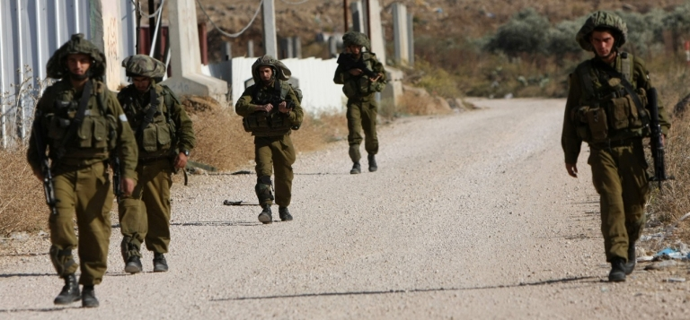 <p>Israeli soldiers patrol in the Golan Heights, near the border of Syria and Lebanon.</p>