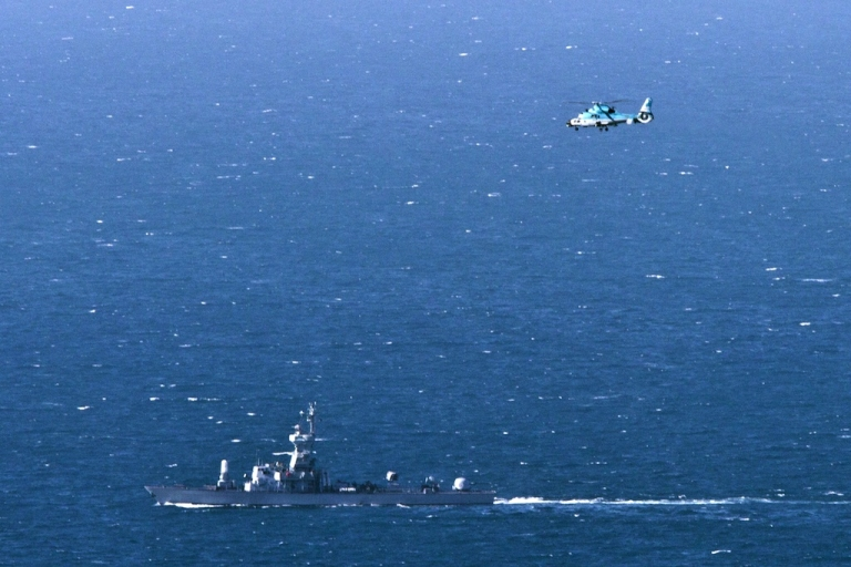 <p>An Israeli navy vessel and helicopter search for the wreckage of a drone which was shot down by the air force off Israel's northern coast on April 25, 2013.</p>