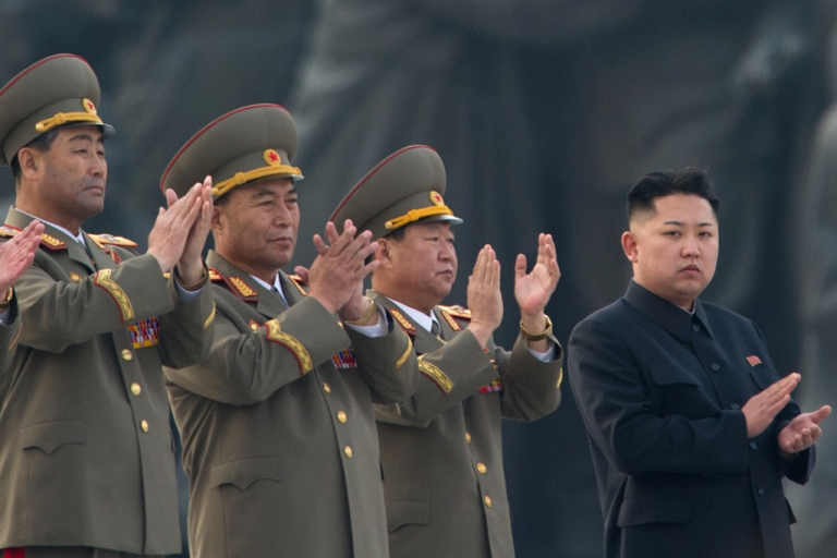 <p>Kim Jong Un claps as he attends the unveiling ceremony of two statues of former leaders Kim Il Sung and Kim Jong Il in Pyongyang on April 13, 2012.</p>
