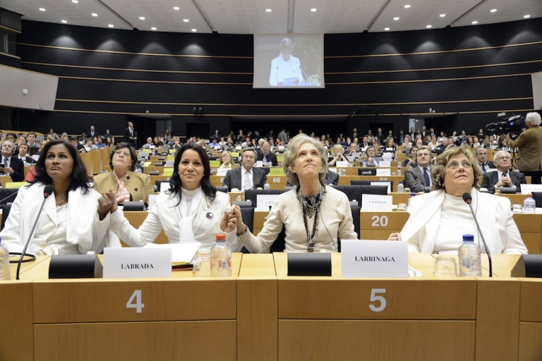 <p>(L to R) Cuban Ladies in White (Damas de Blanco) Laura Maria Labrada Pollan, Belkis Cantillo Ramirez, Elena Larrinaga and Blanca Reyes Castanon hold hands at the European Parliament in Brussels on April 23, 2013. Over seven years after they were awarded the Sakharov Prize for Freedom of Thought by the European Parliament, they were able to receive their award.</p>