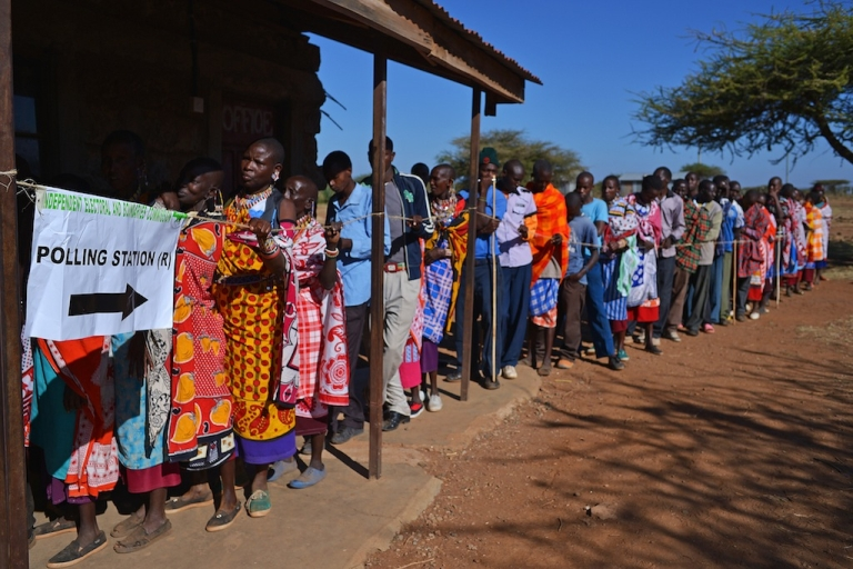 <p>Maasai people queue to vote in Ilngarooj, Kajiado County, Maasailand, on March 4, 2013 during the nationwide elections.</p>