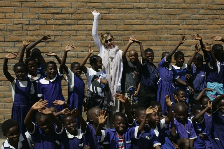 <p>Madonna and her children David (to her left) and Mercy (to her right) visited Mkoko Primary School, one of the schools her Raising Malawi organization has built jointly with US organization BuildOn, on April 2, 2013.</p>
