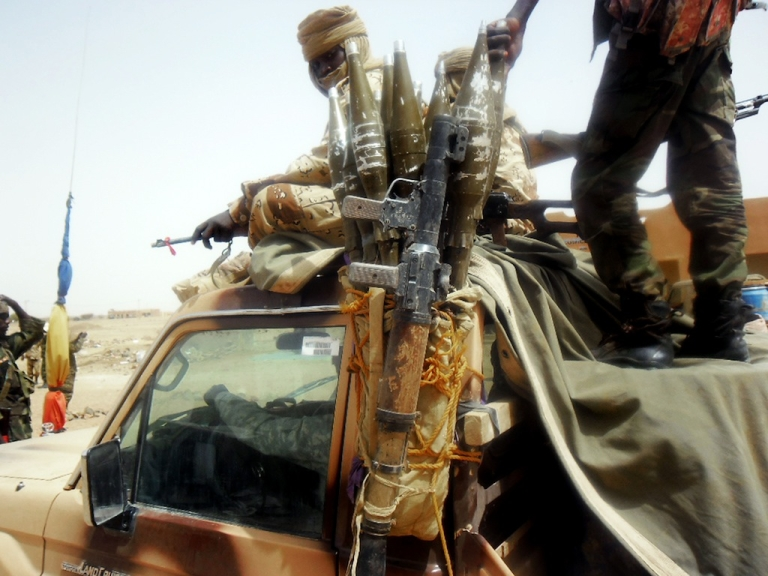 <p>Chadian Army soldiers patrol the northeastern Malian city of Kidal on April 16, 2013.</p>