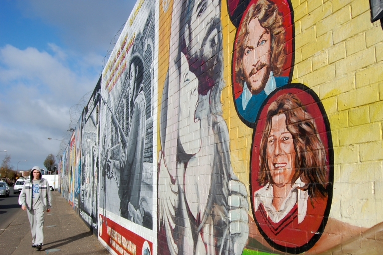 <p>A Belfast mural depicts Bobby Sands and the nine hunger strikers who died in Maze prison in 1981. A plan to turn the former prison into a museum has prompted fierce debate.</p>