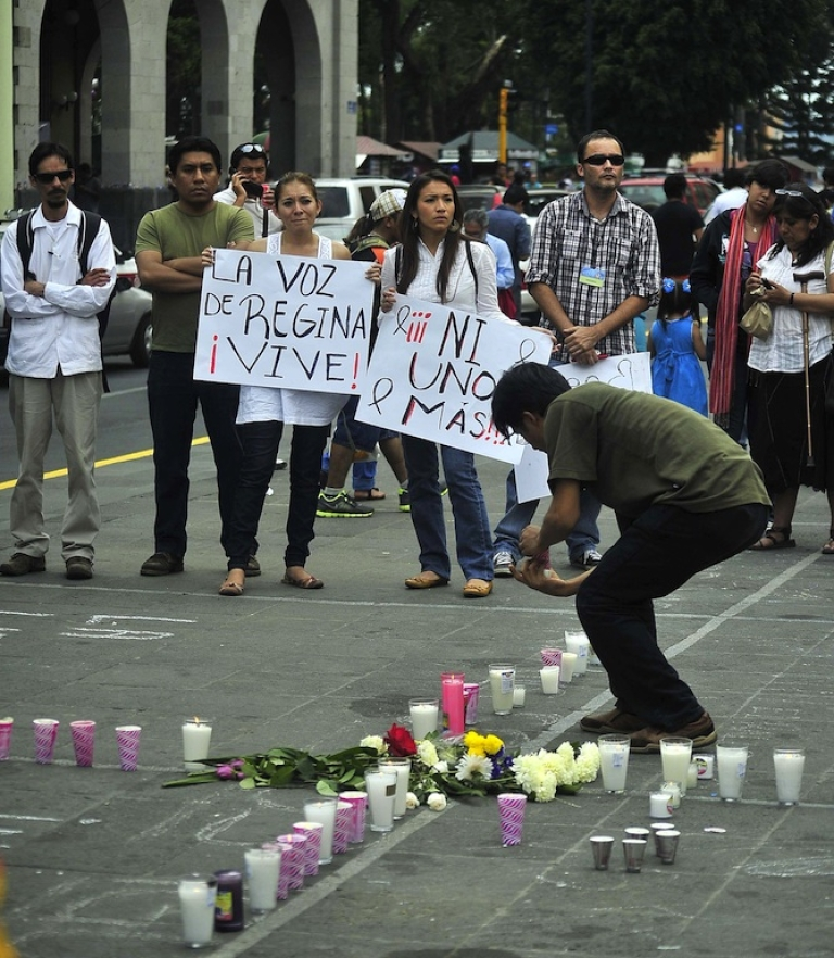 <p>Protesters take to the streets following the murder of Mexican journalist Regina Martinez in Xalapa, Veracruz, on April 29, 2012.</p>