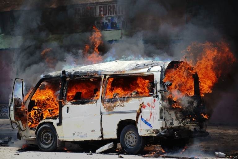 <p>A mini bus catches fire after a car bomb explosion in central Mogadishu on March 18, 2013. The attack is the worst in Mogadishu since September 2012, when two suicide bombers killed 18 people in a restaurant.</p>