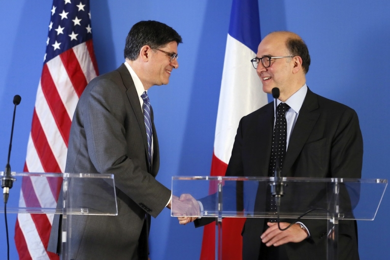<p>French Economy, Finance and Foreign Trade Minister Pierre Moscovici (R) shakes hands with US Secretary of Treasury Jacob Lew after giving a press conference on April 9, 2013, following a meeting at the US Embassy in Paris.</p>