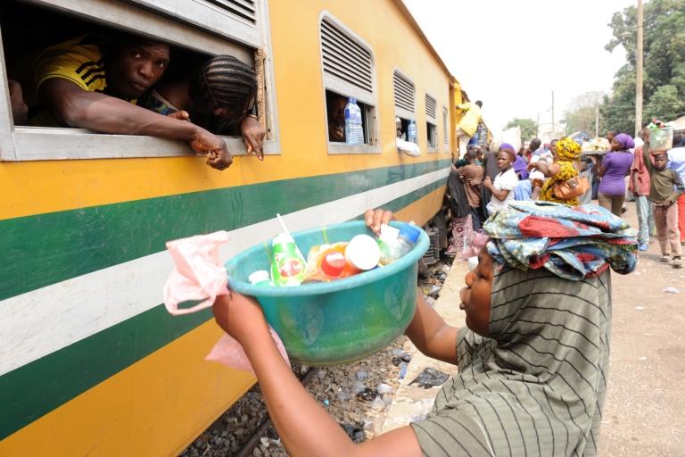 <p>Roadside vendors sell drinks to Nigeria Railway passengers on board the Lagos-Kano train at Minna Station.</p>