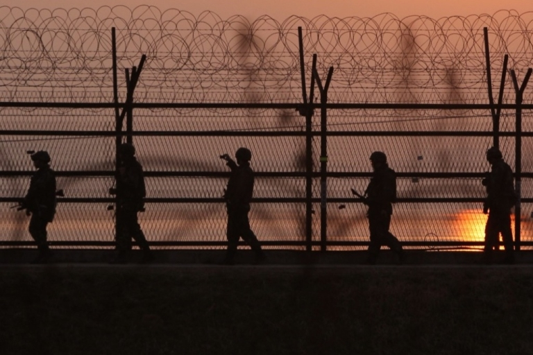 <p>South Korean soldiers patrol inside the barbed-wire fence near the border village of Panmunjom on April 4, 2013 in Paju, South Korea.</p>