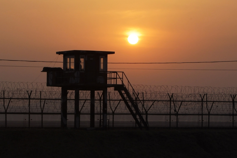 <p>The sun sets near the border village of Panmunjom on April 4, 2013 in Paju, South Korea.</p>