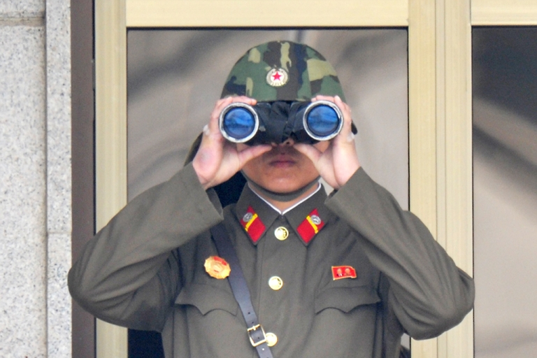 <p>A North Korean soldier at the truce village of Panmunjom in the demilitarized zone on April 23, 2013.</p>