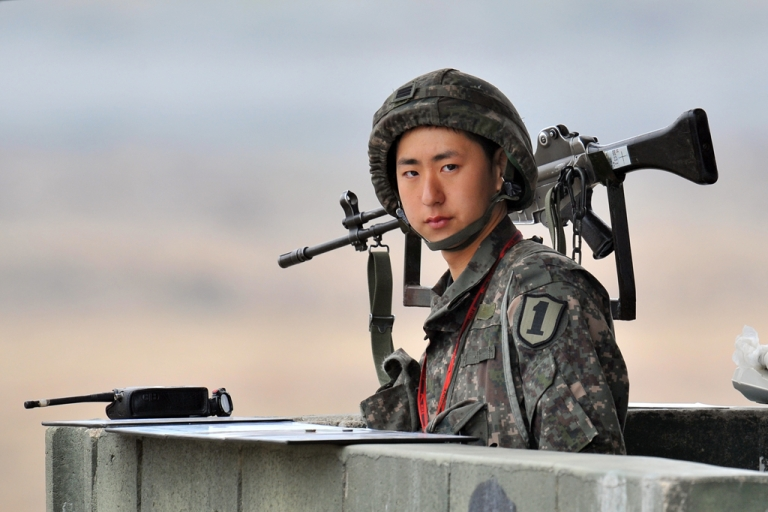 <p>A South Korean soldier stands on a military guard post near the demilitarized zone (DMZ) dividing the two Koreas in the border city of Paju on April 5, 2013. The United States said it was taking