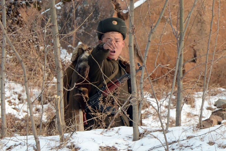 <p>A North Korean soldier reacts as he patrols along the Yalu River near the North Korean town of Sinuiju after the country conducted it's third nuclear test on February 12, 2013.</p>