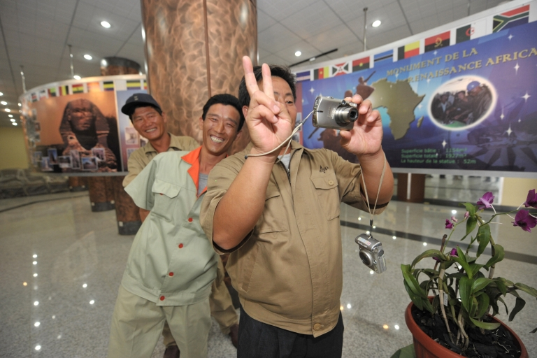 <p>North Korean workers take a picture in the