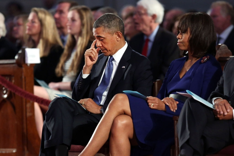 <p>President Barack Obama (L) and first lady Michelle Obama attend an interfaith prayer service for victims of the Boston Marathon attack titled