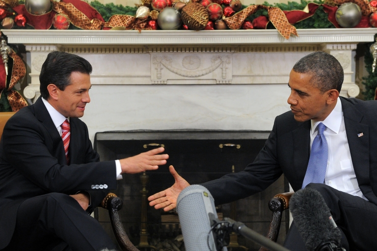 <p>US President Barack Obama shakes hands with Mexico's then-president-elect, Enrique Peña Nieto, during a bilateral meeting in the Oval Office at the White House in Washington on Nov. 27, 2012.</p>