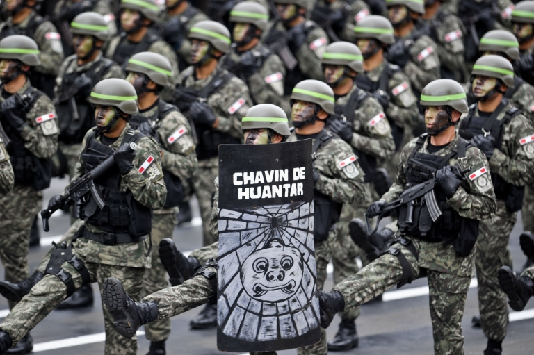 <p>Peruvian Army special forces march during a military parade to celebrate the country's independence.</p>