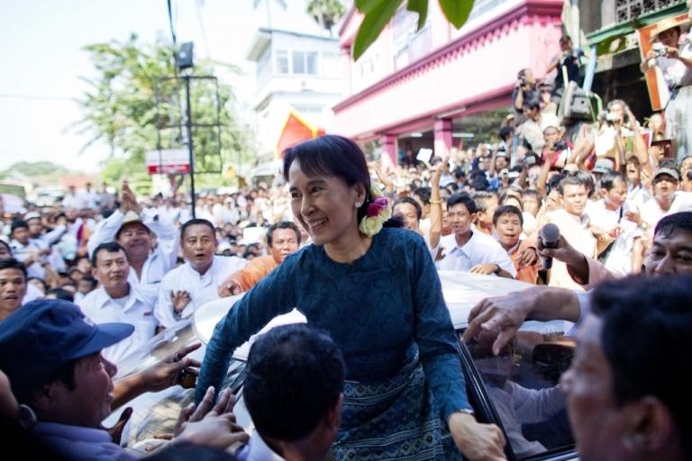 <p>Aung San Suu Kyi arrives at the National League for Democracy headquarters on Nov. 14, 2010, in Yangon, Burma.</p>
