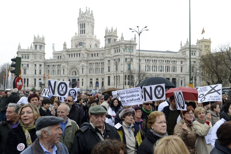 <p>Demonstrators take part in a protest against government's austerity measures and health care spending cuts in Madrid on March 17, 2013.</p>