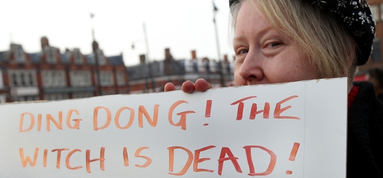 <p>A woman poses next to a sign displaying the message 'Ding Dong! The Witch is Dead!' as she celebrates the death of former British Prime Minister Margaret Thatcher on April 8, 2013 in London, England.</p>