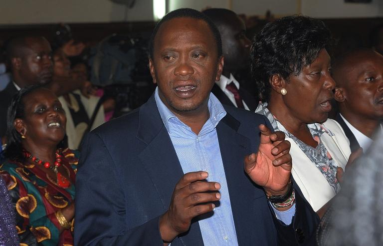 <p>Uhuru Kenyatta attends a church service on March 31, 2013, at St. Austin Catholic church in Lavingtone, Nairobi.</p>