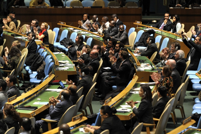 <p>Delegates to the United Nations General Assembly April 2, 2013 applaud the passage of the first UN treaty regulating the international arms trade. US Secretary of State John Kerry signed the Arms Trade Treaty on September 25, 2013.</p>
