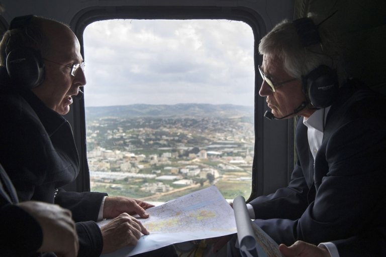 <p>US Secretary of Defense Chuck Hagel and Israeli Minister of Defense Moshe Yaalon speak during a helicopter tour above the Golan Heights, on April 22, 2013. Hagel met his counterpart to put the finishing touches on a major arms deal and for talks on Syria's civil war and the Iranian nuclear threat.</p>