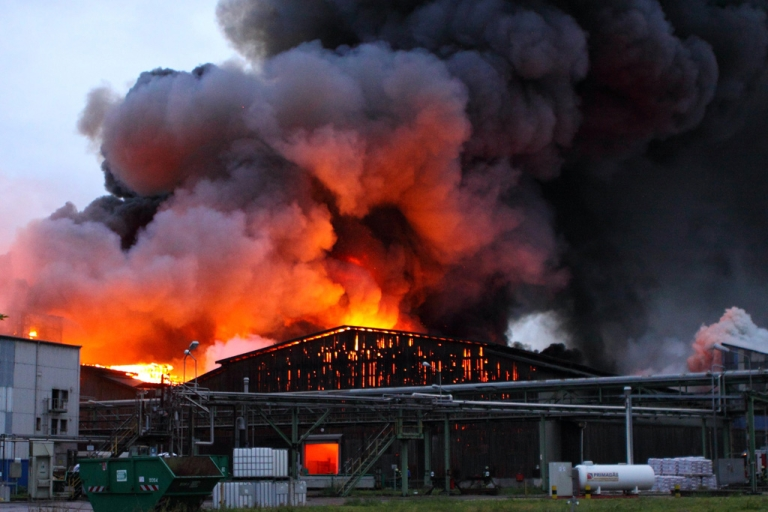 <p>Flames and smoke rise from a burning storage building of a fertilizer plant in Krefeld, Germany, on September 25, 2012. Fire brigades are testing if the cloud is toxic and asked residents to keep their windows closed.</p>