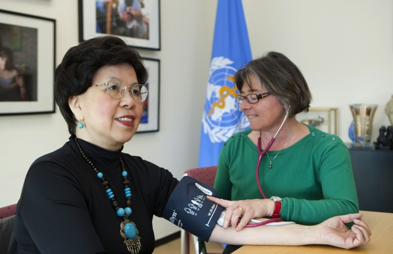 <p>Dr. Margaret Chan, Director-General of WHO, having her blood pressure taken.</p>