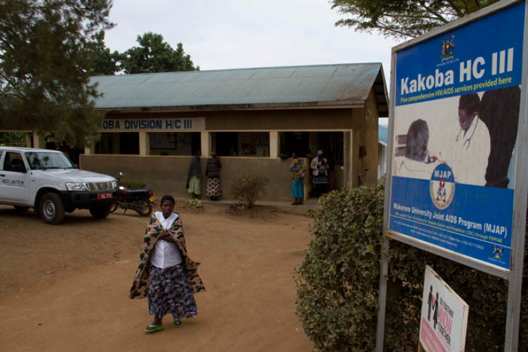 <p>Patients stand outside the Kakoba Division Health Centre III in Mbarara, Uganda, about 330 kilometers west of Uganda's capital city.</p>