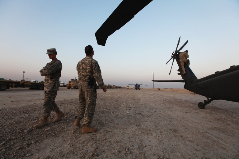 <p>US Army National Guard soldiers prepare to depart in a Medevac helicopter to assist the last convoy from Iraq at Camp Adder, now known as Imam Ali Base, on December 17, 2011 near Nasiriyah, Iraq. The US is considering sending military aid for a no-fly zone in Iraq with hope of stemming conflict in Syria.</p>