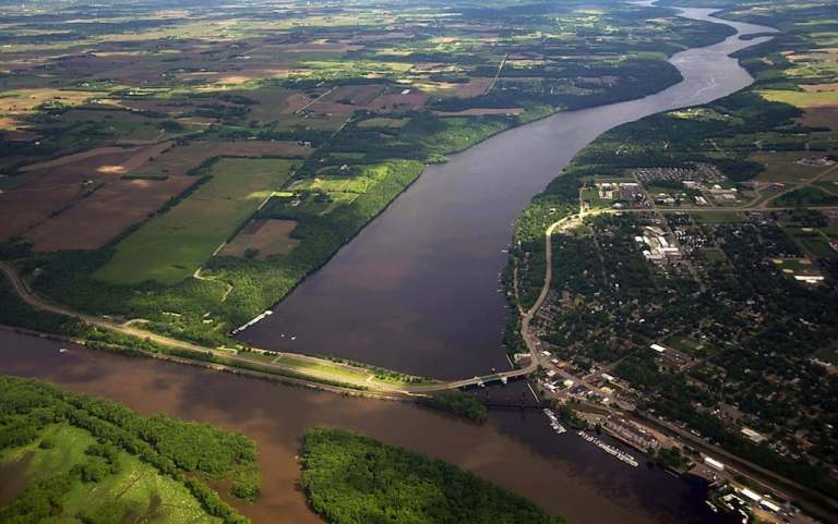 <p>The confluence of the St. Croix and Mississippi Rivers is seen from the air on May 31, 2012. Rivers in the eastern United States are becoming more alkaline, according to a new study. Alkalinity can complicate sewage treatment and increase algae levels.</p>