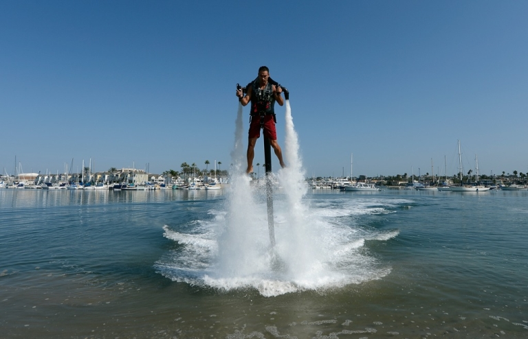 <p>Dean O'Malley rises above the water using a JetLev, a water-powered jetpack, in the Newport Beach harbor on September 25, 2012.</p>