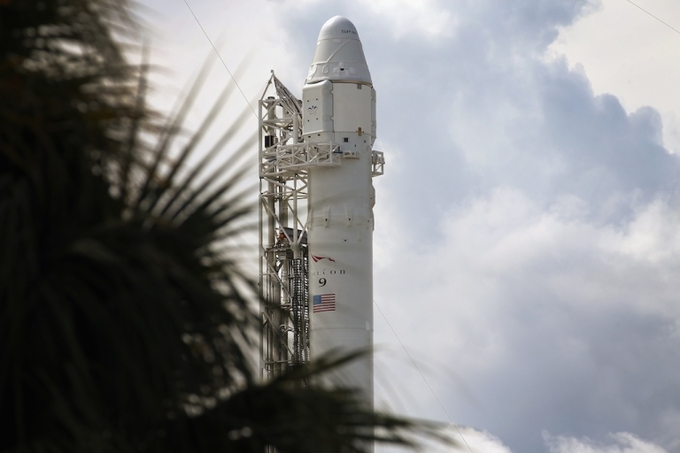<p>A SpaceX Falcon 9 rocket attached to the cargo-only capsule called Dragon sits on the lauch pad for a scheduled evening launch on October 7, 2012 in Cape Canaveral, Florida.</p>