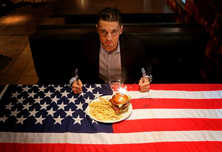 <p>Nathan Cleverly poses with a hamburger during a press conference to announce his upcoming WBO Light Heavyweight Championship bout in The United States with Ryan Coyne at Planet Hollywood on October 8, 2012 in London, England. Hamburgers and American-style beer are increasingly popular in London.</p>