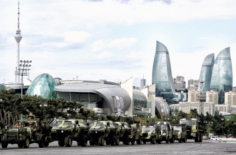 <p>Military vehicles drive through Baku, the capital of Azerbaijan, on June 21, 2013, during a rehearsal for a military parade. Street protests are usually quickly repressed in the authoritarian former Soviet state.</p>