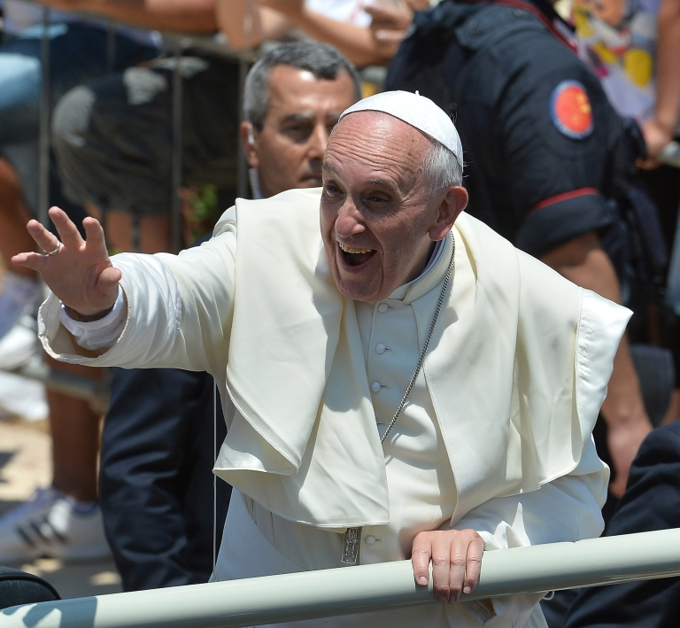 "<p>Pope Francis waves to the faithful after visiting San Gerlando church during his visit to the island on July 8, 2013 in Lampedusa, Italy, where he spoke about the ""globalisation of indifference."