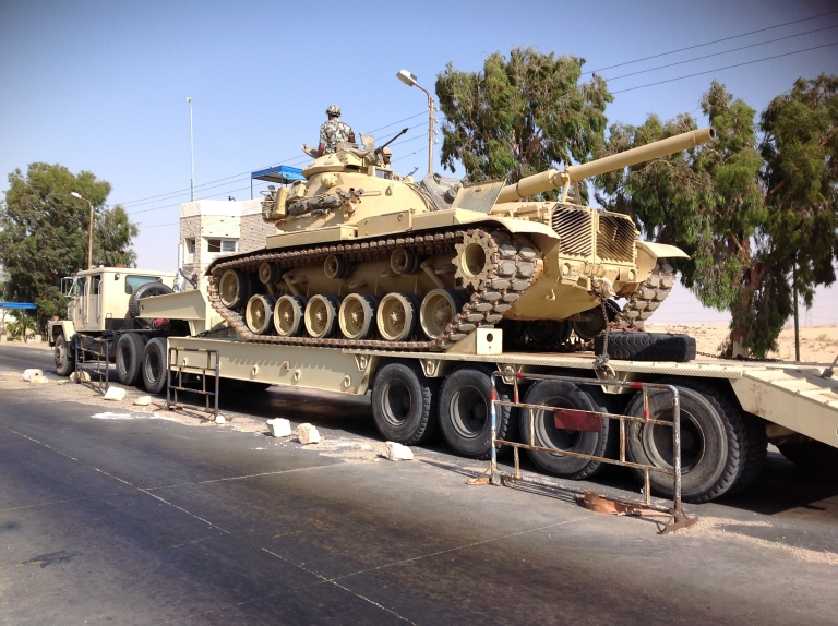 <p>An Egyptian military tank is deployed in the northern Sinai town of Al-Arish on July 16, 2013. US government contractors supply Egypt with hundreds of tanks which are never used.</p>