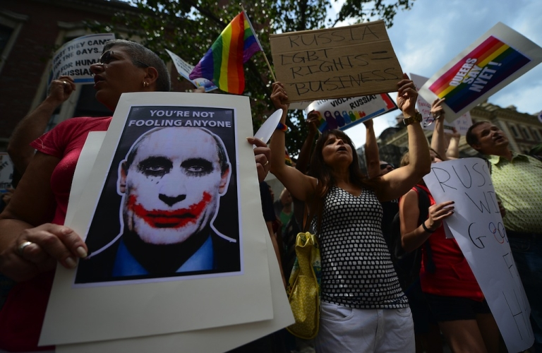 <p>Protesters hold a demonstration against Russian anti-gay legislation and against Russian President Vladimir Putin stands on gay rights, in front of the Russian Consulate in New York, July 31, 2013.</p>