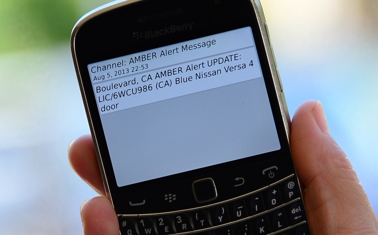 <p>A cellphone displays the Amber Alert issued late on August 5, 2013 in Los Angeles, California, which marked the first time officials have notified the public of a statewide Amber Alert through their cellphones. The alert was in reference to James Lee DiMaggio, suspected of killing Christina Anderson, 44, and kidnapping one or both of her children: Hannah Anderson, 16, and Ethan Anderson, 8.</p>