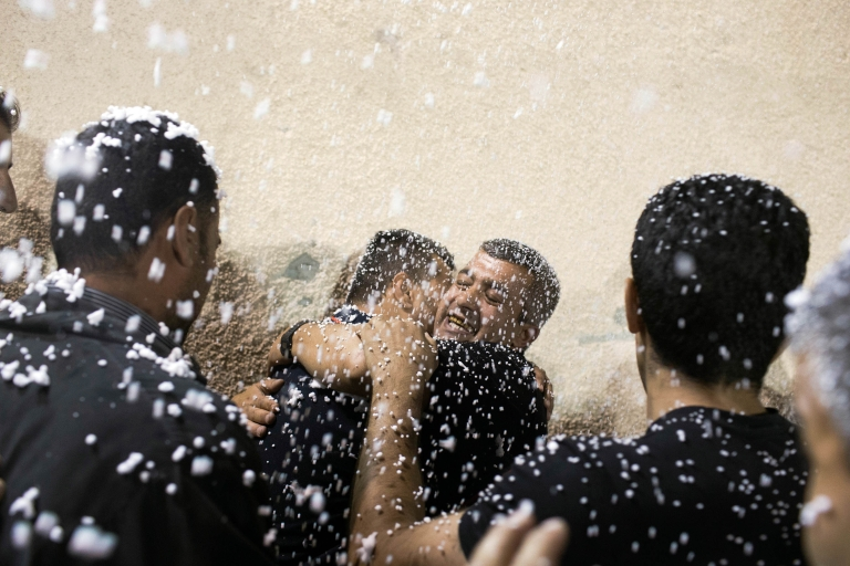 <p>August 14, 2013- Families celebrate the release of 11 Palestinian prisoners from an Israeli jail in the Mikatah compound in Ramallah, West Bank. Officials said on Dec. 30 that Israel was set to release another 26 Palestinian prisoners in the third of the four-stage release agreed upon in peace talks.</p>