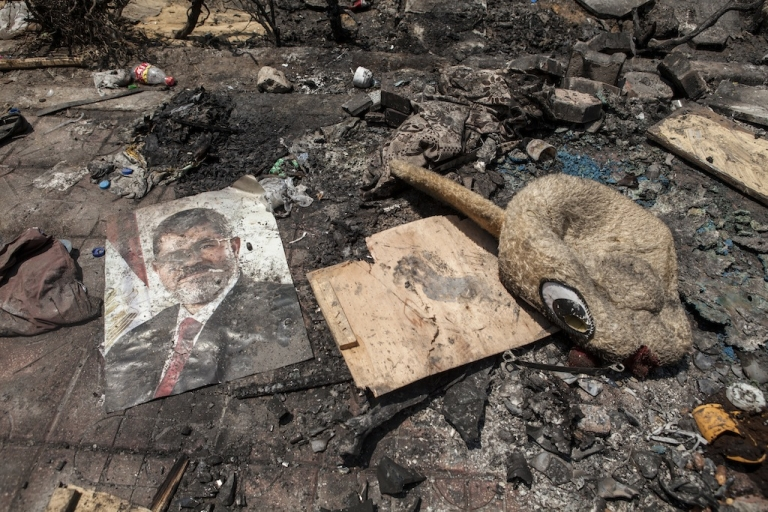 <p>A poster of deposed Egyptian President Mohamed Morsi lies in the debris left outside the Rabaa al-Adaweya Mosque in Nasr City on August 15, 2013 in Cairo, Egypt.</p>